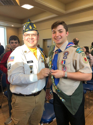 Logan Bayer (right) is congratulated by Commander Mike Klanang upon receiving the Eagle Scout Award. Congratulations Logan!