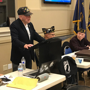 Woody Hughes, a USMC veteran of WWII and Iwo Jima, speaks about his experiences to Post 690 veterans.
