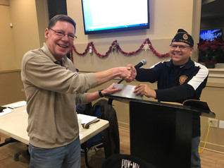 Post 208 makes a donation to Post 690. Thank you.
