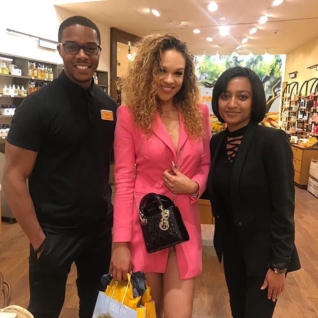 Client, Shanice Gaither pictured with the team of L'Occitane after a successful event