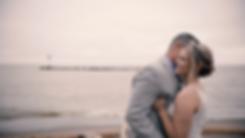 Bridget & Justin on beach, whispering in