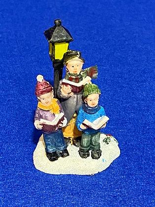 Coro con bambini e lampione