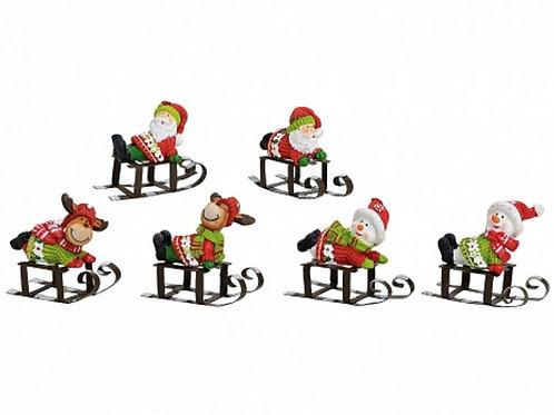 Personaggi Natale su slittini ferro 5 cm