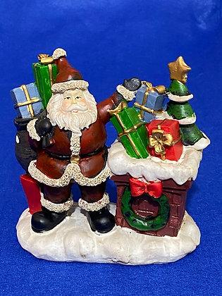 Babbo Natale con doni su comignolo, 10 cm