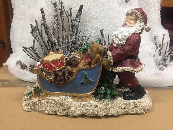 Babbo Natale con slitta e luci
