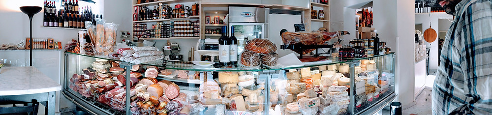 Meat and cheese counter at La Drogheria del Buongusto, Palermo, Sicily. Sicily South, experience Sicily like a local.