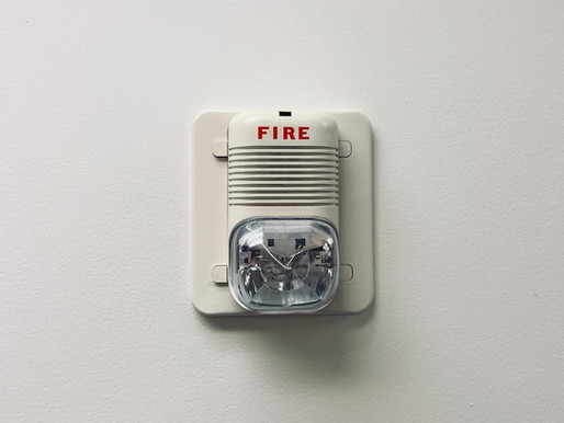 Who Can I Sue if My New York House Burns Down Due to a Faulty Fire Alarm?
