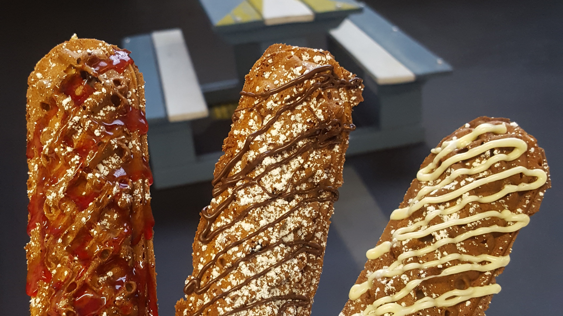 A gorgeous waffle on a stick, with a sauce