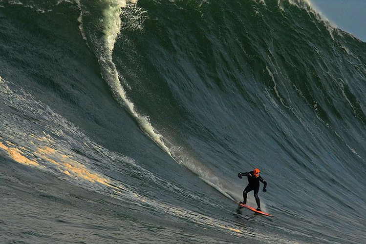 Al Mennie speeding into the jaws of another Monster wave