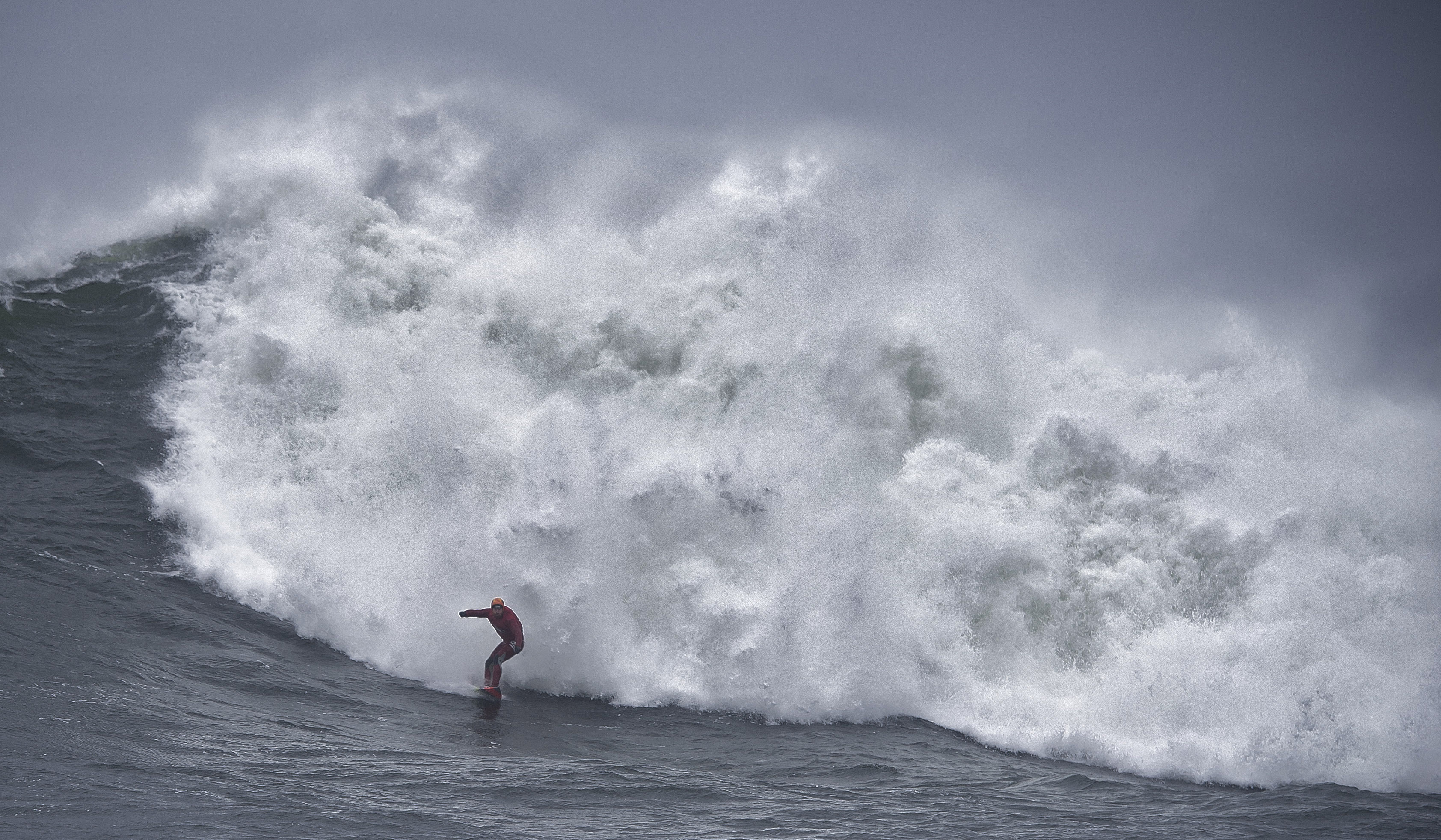 Al Mennie surfing over a submerged reef far off the west coast. Picture by Charles McQuillan