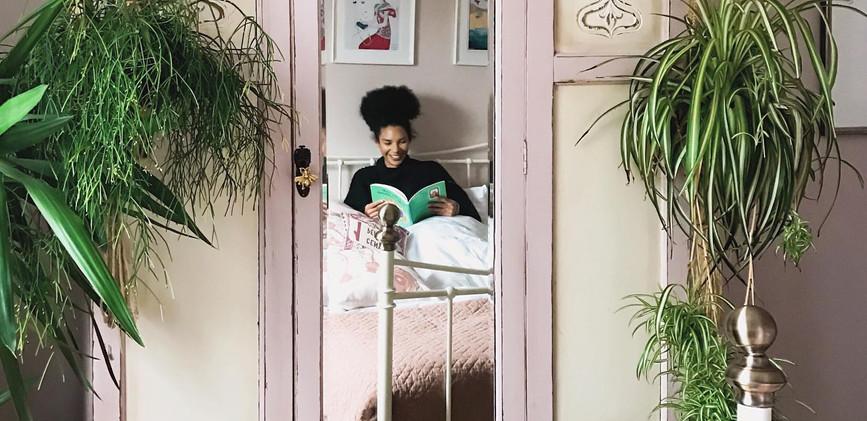 mariam in bed reading.jpg