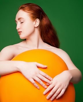 Girl Hugging Orange Ball