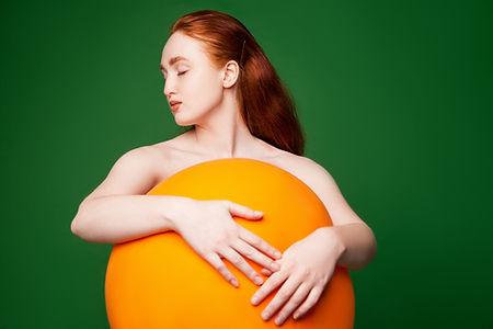 Girl Hugging Orange Ball