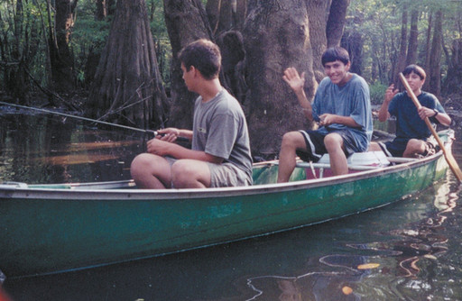 Logan, Eddie, and Billy in canoe catching some fish.