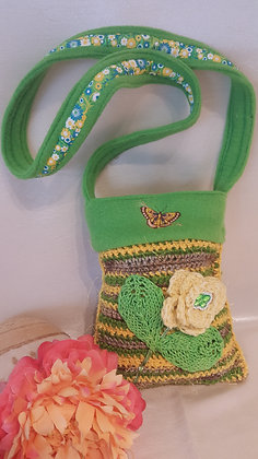 Children's knit purse with crocheted flower and imbroidered butterfly.