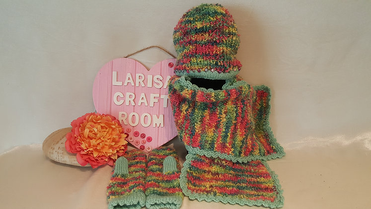 Girl's knit set of hat, scarf and mittens.