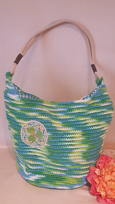 Crochet hand bag with imbroidered lucky cloverleaf design.