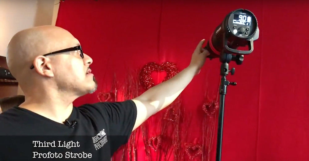 this 2nd strobe is lighting more of the ornaments on the red backdrop, behind the model