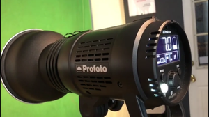 Here we have an image of a photo studio with a green screen backdrop. This studio strobe will light the backdrop to help evenly expose the backdrop