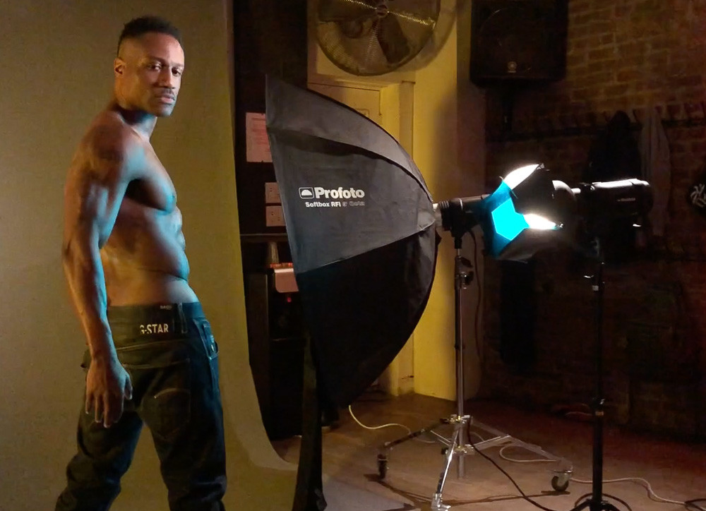 Here's a photo of a studio strobe with a blue teal colored gel attached to it, to light up the subject's torso.
