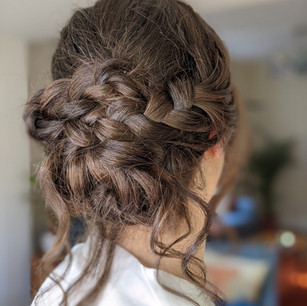 Romantic textured braided bridal updo