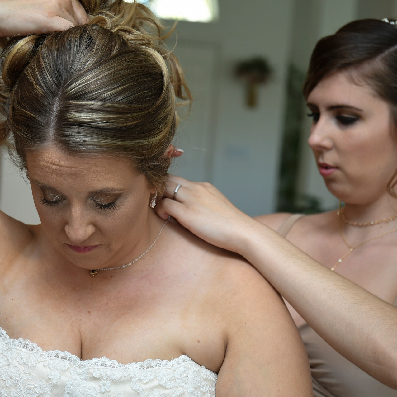 Priceless memories between the bridal party and bride during wedding prep.