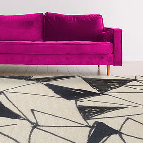 black and white rug with pink sofa-sqaur