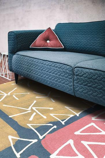 Geo colour rug with teal sofa.jpg