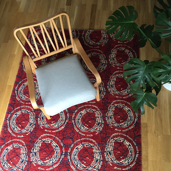 linden chair reupholstered on monach rug