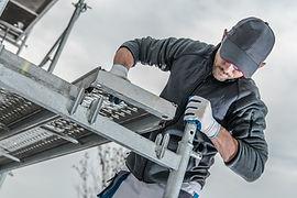 Caucasian Construction Worker Installing