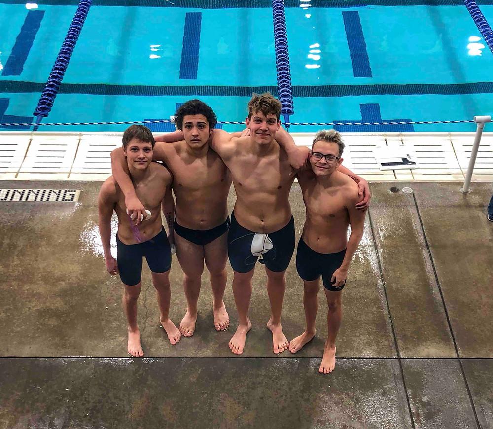 Swim Lessons Instructor James celebrating a successful High School Swimming Regionals