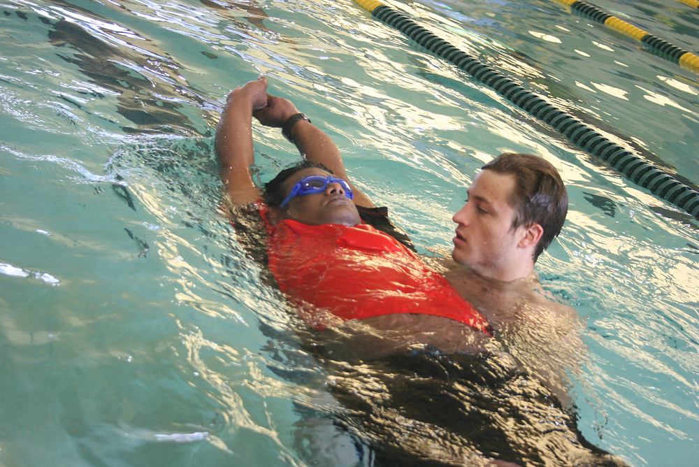 Sigma Adult Learn-to-Swim Instructor Ryan teaches floating to one of Sigma Swimming's Adult Swim School students