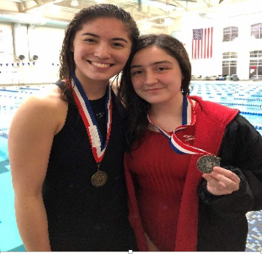 Madison Huertas (right) with Sigma Swim teammate Taylor Bresnahan
