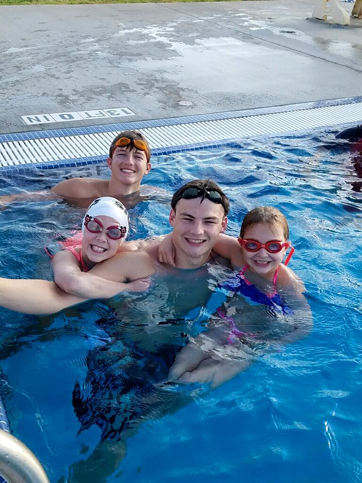 Coach Nic's swimmers love him