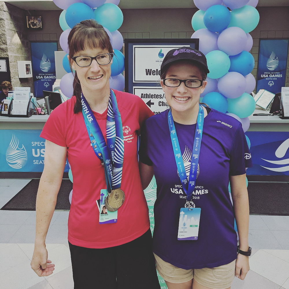 Special Olympics Swim Coach Lauren Bach with one of her Special Olympians