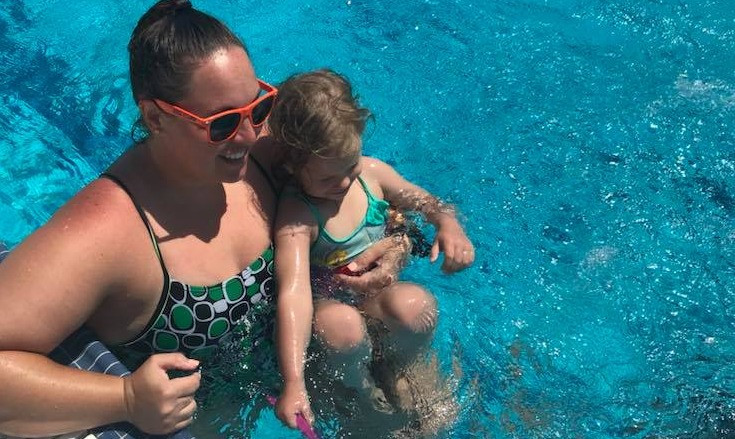Sigma Swim Coach Wendy instructs one of her swim lessons children