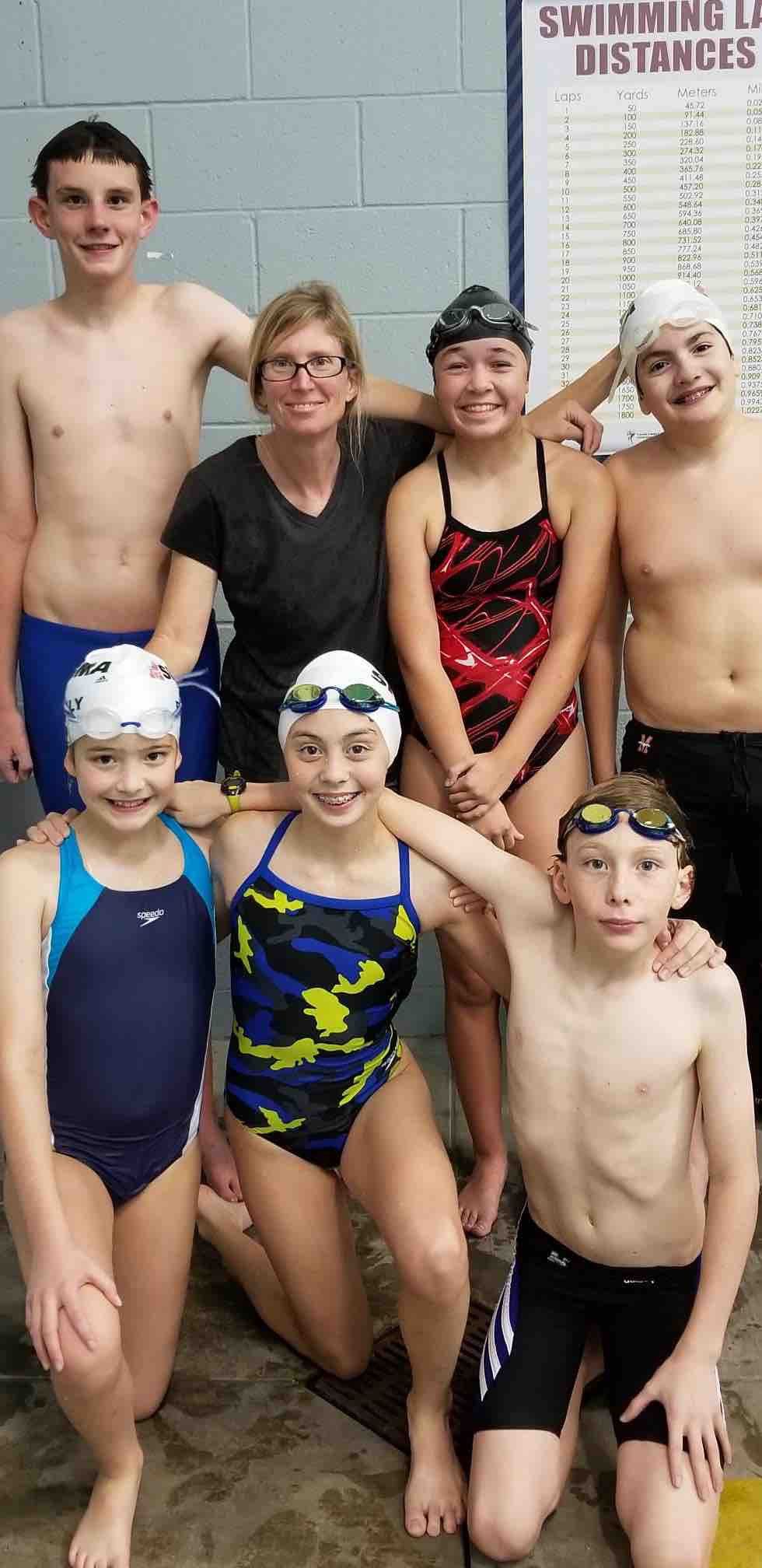 Coach Jill with some of her swimmers from Sigma Swim Fort Worth North