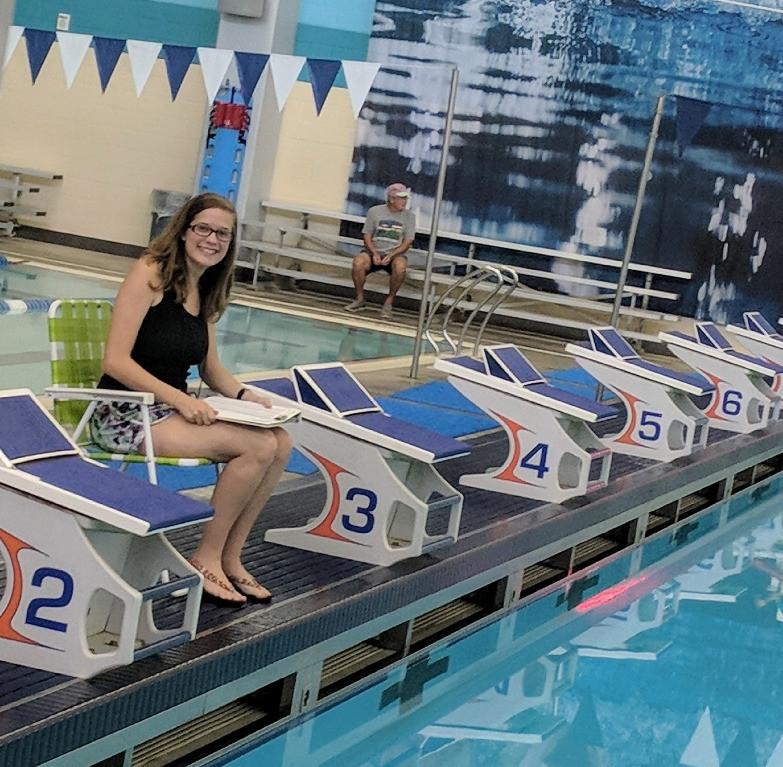 Special Olympics Swim Coach Lauren taking splits in Lewisville