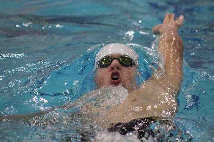 Sigma Swim School Coach James competes in his signature backstroke event.