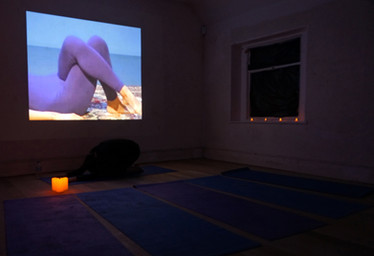Grace Connors, I went to a bikram yoga class and all I got was a pat on the back and a grande caramel soy latte, 2017, performance, single channel video, audio, installation of found objects. Photo by Jess Boyce