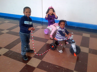 Children playing together at the gym. Lo