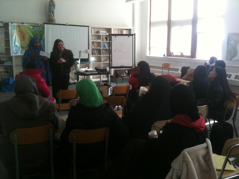 Explaining micro loans to women.JPG