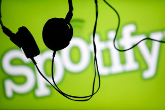 SPOTIFY MOBILE APP MONETIZATION OPENS WITH RESTRICTIONS