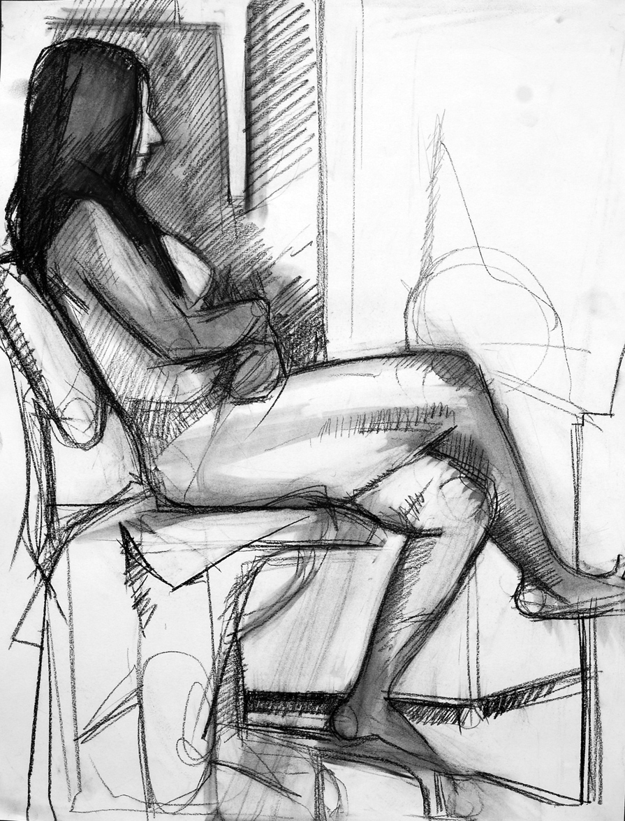 Lyles_female model in chair_Charcoal and