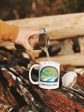Lincoln Park coffee mug. Man pouring coffee on log in Seattle.