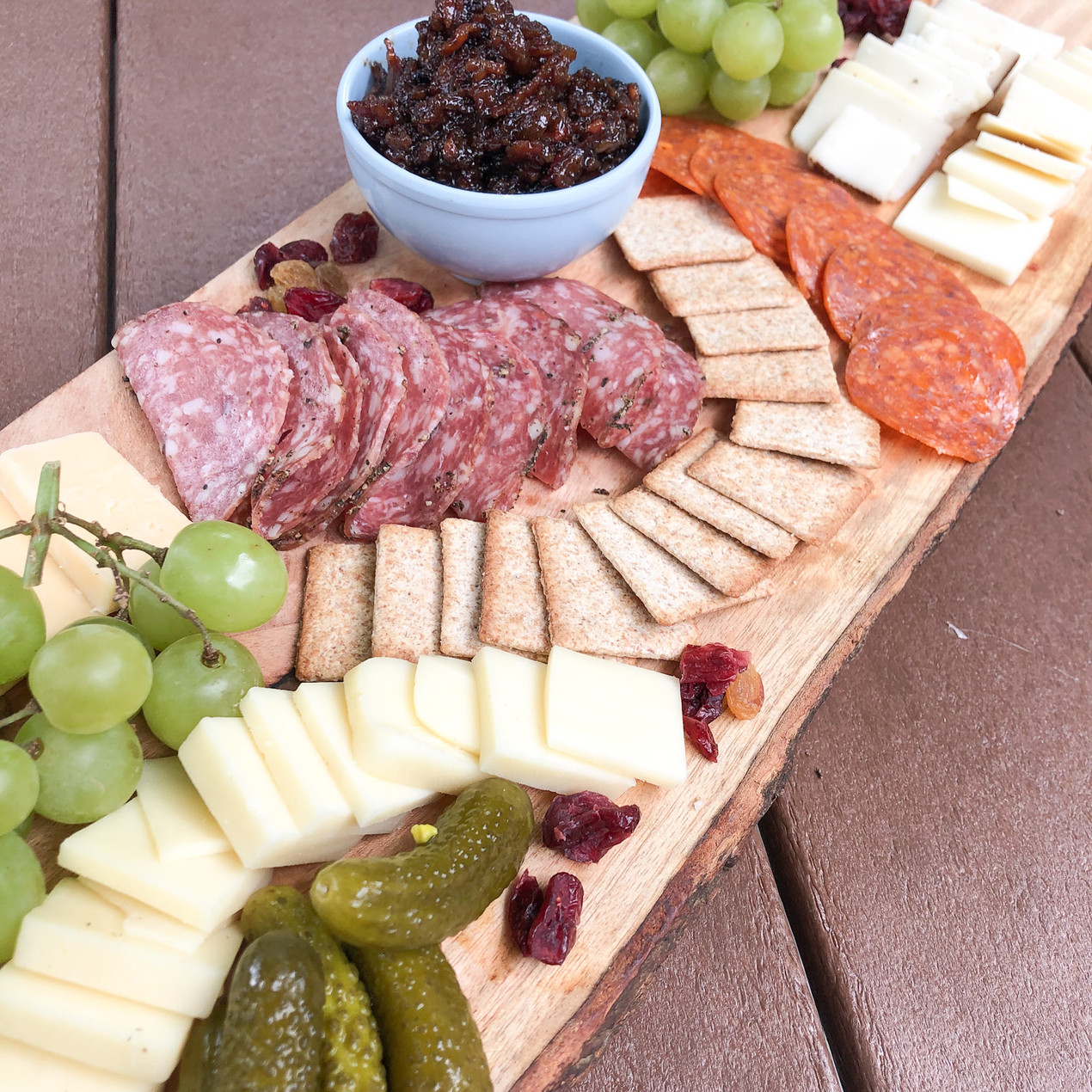 Charcuterie Board bacon jam cheese crackers pickles appetizer