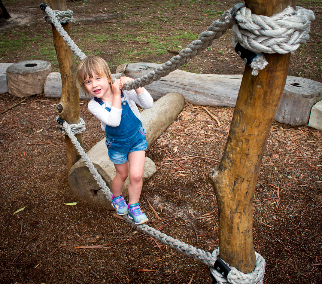 Child playing on Rope Climber