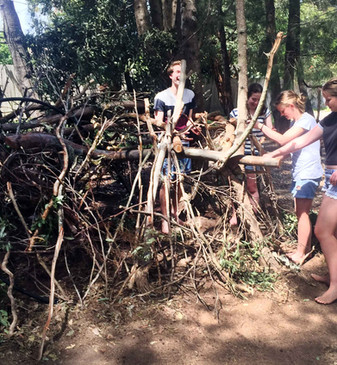 Teanagers enjoying Self-build nature play at Asquith Park