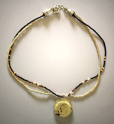 Beaded with pebbled pendant