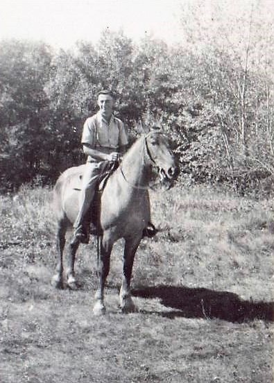 Young man (age 22) with his horse